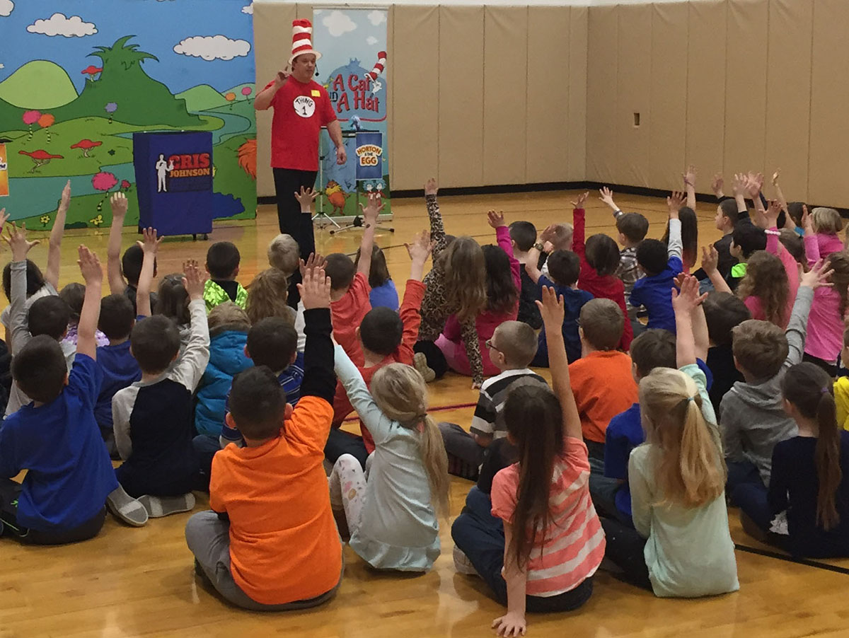 dr seuss themed assembly, cris johnson, a cat and a hat